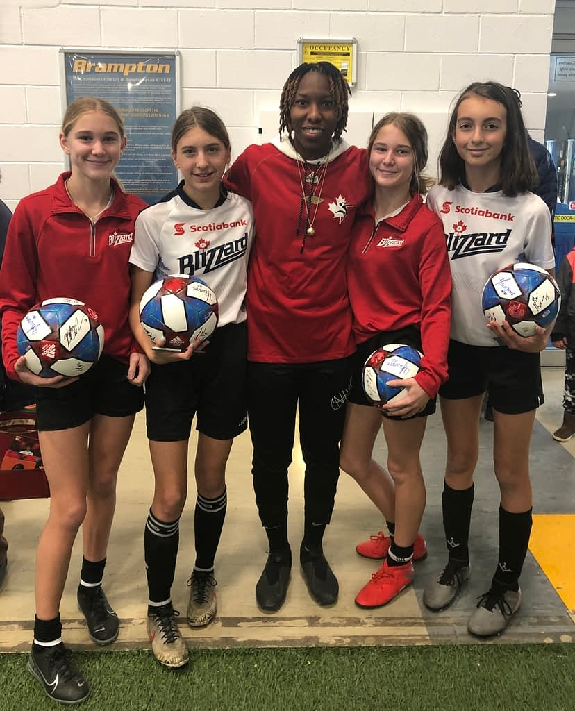 "Toronto Blizzard players with Ashley Lawrence at ""Yes She Canada"""